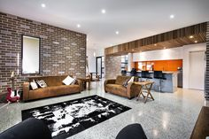 House by  Swell Homes Decorated in Brick Veneer Inside and Out