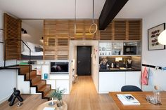 Living in a shoebox | Hotel room boasts retractable staircase and hideaway loft bed