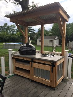 Our custom grill cart with a Primo grill and Flame King 2 burner stove. Big Green Egg Outdoor Kitchen, Outdoor Bbq Kitchen, Outdoor Barbeque, Outdoor Sinks, Backyard Kitchen, Outdoor Kitchen Design, Outdoor Grill Area, Outdoor Grill Station, Outdoor Cooking Area