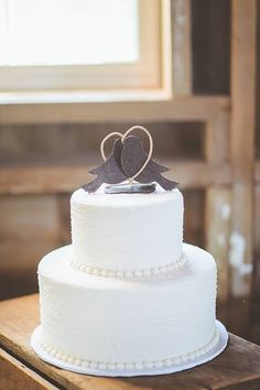 White Wedding Cake with Lovebird Toppers