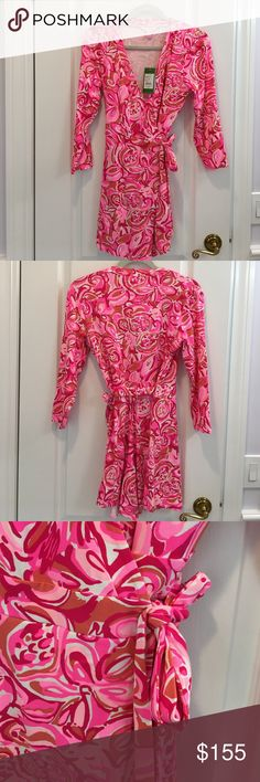 NWT Lilly Pulitzer Romper. Karlie Wrap Romper in pink pout mango salsa. Ties on side. 3/4 sleeve. 96% rayon 4% spandex. Hand wash. Low v neckline. Lilly Pulitzer Dresses