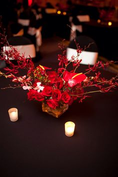 Rock and roll red wedding - red orchid and roses low wedding centerpiece