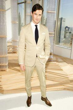 Shop this look on Lookastic:  http://lookastic.com/men/looks/dress-shirt-tie-pocket-square-suit-derby-shoes/10644  — White Dress Shirt  — Black Tie  — White Pocket Square  — Tan Suit  — Brown Leather Derby Shoes