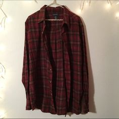 Vintage oversized flannel Red and brown/black vintage flannel. Very soft and comfortable. No flaws and great colors. Worn as flannel dress or oversized top Brandy Melville Tops Button Down Shirts