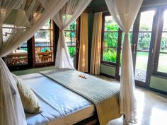 Veranda suite with a side terrace overlooking the garden.and sea. At villa Semadhi, in Pemuteran.
