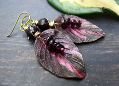 RESERVED FOR MAUDE Goodbye Blackberry Way - wearable art polymer clay berry shade garnet gold leaf earrings. by PreciousViolet on Etsy https://www.etsy.com/listing/510206767/reserved-for-maude-goodbye-blackberry