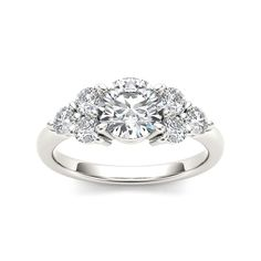 <li>Round-cut white diamond ring</li><li>14k white gold jewelry</li><li><a href='http://www.overstock.com/downloads/pdf/2010_RingSizing.pdf'><span class='links'>Click here for ring sizing guide</span></a></li>