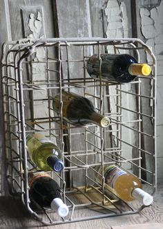 Turn a vintage milk bottle crate onto its side and use it as a wine rack. Love it........D.