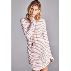 Thermal dress with coral stripes. Flattering ruching on sides. Dresses
