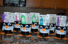 Penguin birthday party favor tins, snack ideas (snowballs ie doughnuts, goldfish, and swedish fish in jello)