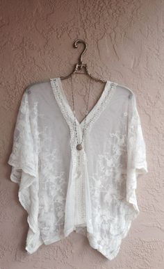 Rustic Charm-lace blouse with long necklace or locket. Could work over a tank or camisole if fabric drapes well. Needs to fit through bust and under arms to accentuate most narrow area at bottom ribs/above waist. Should stop at top of hip level to avoid looking bulky. Too boho for some...