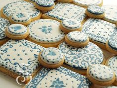 Blue & White cookies made using the wet-on-wet royal icing technique.