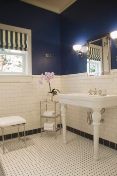 Navy blue and white tile half bath
