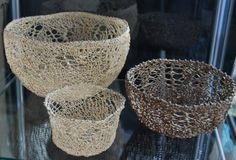 Julie Pongrac  Hand knit lace bowlst. Material(s): Vine or Hanji paper embellished with glass beads and wire.  Vancouver artist