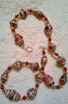 Christmas paper bead necklace made from beads I rolled from a Christmas gift top box.