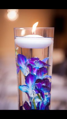 Floating candle & orchids  Perfect for center pieces