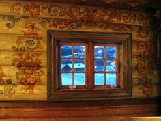 Folk museum in Heddal, Norway: Rosemaling (Norwegian rose painting) embellishes wooden surfaces of all kinds — furniture, cabinetry, walls, fiddles.