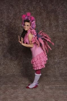 """Mayzie from Seussical the musical wearing a  fuchsia dress, belt w/""""feathers"""", headband rental price  $40.00"""