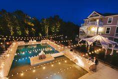 Lighting over pool and perimeter lighting accent this beautiful fall reception in Corolla, NC at the Black Stallion rental home through Twiddy & Co.  Photo by Joshua Kane Photography; Lighting by Blue Steel Lighting; Wedding Planning by Platinum Party Planning
