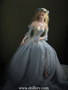 "Tom Francirek Collectible Doll ~ Isabella - Forget Me Not, $ 3,800.00 Limited edition of 15, one of a kind costuming.  Porcelain head, bust, arms & legs. Blond angora mohair, blue painted eyes. Silk organza, jacqard, Chantilly lace, pearls, crystals. 17"" tall"