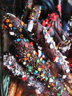 chocolate dipped pretzel sticks.  YUM! Fun to decorate. Homemade gifts the kids can make with you!