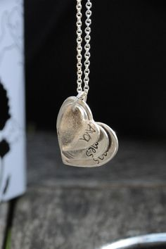 "Family fingerprint pendant. I have been looking for a ""grandma"" necklace...this would be great and easy to add to as kids come along!"