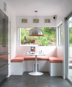 Love this rust/orange banquette seating in the kitchen.