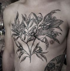 The black ink plant and a bird tattoo on the breast