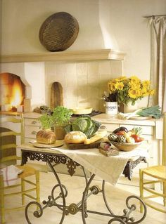 French Style Plaster Stove Hood Witha Wood Burning Oven In A Fresh New Kitchen Love The Wrought Iron Marble Top Table