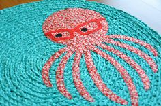ocean hipster decor: a trendy teal rug with a glasses-wearing octopus!