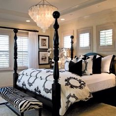 Interior Design by Barclay Butera. Black and white bedroom with damask lamp, zebra ottoman, four post bed, and Capiz Shell Chandelier. I LOVE capiz she'll ANYTHING. Style At Home, Dream Rooms, Dream Bedroom, Pretty Bedroom, Bedroom Black, Black And Cream Bedroom, Black Beds, Black White Bedrooms, Closet Bedroom