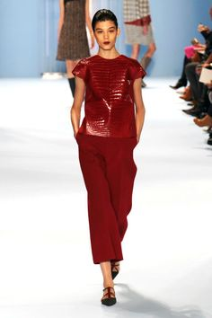 She can do minimal, too, just put through an uber-luxurious sieve. How about a set of fire-engine red exits that centered the collection. Who else but Herrera could do a t-shirt in glossy red croc? The loose, cropped trousers worn with flat shoes felt effortless and of-the-moment.