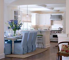 blue slipcovers, white kitchen