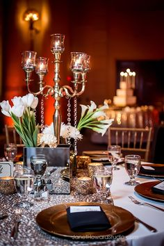 Gold and black with white flowers and candles. Wedding reception at Fox Theater, Atlanta
