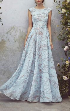 """The designers: The Italian matriarch is known for her dreamy dresses—just google her daughter (and co-designer) Lucilla's recent wedding for a taste of her fairytale aesthetic.  This season it's about: Her always-feminine silhouettes range from a light blue eyelet day dress (one of the season's must-haves) and diaphanous gowns embroidered with wildflowers to personality-rich jumpsuits (the ruffled and striped version would make for a great unexpected """"guest of"""" look)."""