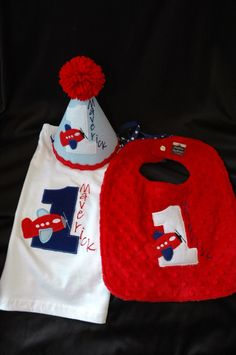 1st Birthday Shirt Hat and Bib Combo Set Airplane Theme or have me create a set in your theme and colors. $69.95, via Etsy.
