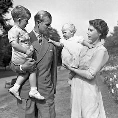 Princess Anne in the arms of Princess Elizabeth, with the Duke of Edinburgh, holding Prince Charles, in the grounds of Clarence House, their London residence Prince Philip, Prince Of Wales, Prince Charles, Royal Prince, Prince Harry, Clarence House, Her Majesty The Queen, Queen Of England, England Uk