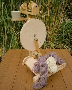 Woodworking plans for Zephyr, a two treadle portable spinning wheel, available at www.lisaboyer.com