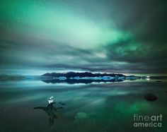 Aurora Borealis Northern Lights over Glacial Lagoon in Iceland