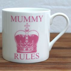 """A bone china mug with the a big, pink crown and the words """"Mummy Rules"""" on both sides of the mug  Measures H 8.5cm x 7.5cm dia."""