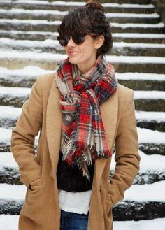 With the winter chill I find I stay so much warmer by wearing a scarf. A stylish way to wear one is the pretzel knot. I love how the scarf lies flat.