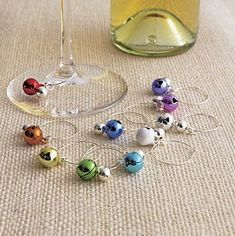 Jingle Bell Wine Charms Set of 10 from Crate Barrel - this would be a fun xmas gift exchange idea Wine Corker, Wine Glass Markers, Home Bar Accessories, Wine Craft, Wine Glass Charms, Jingle Bells, Bottle Crafts, Crate And Barrel, Small Gifts