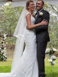 Wedding dress: Bride wears ruched Pronovias gown with sweetheart neckline from Fashions by Farina #weddingdress #bride #groom #bridalgown