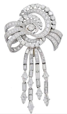 A Diamond and Platinum Bow Pendant/Brooch, circa 1950 Designed as a multi-looped ribbon bow decorated with round diamonds suspending four articulated cascades of baguette-cut and marquise-cut diamond tassels, mounted in platinum