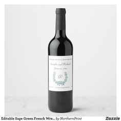 This wine label features a sage green French wreath design. The text is editable so go ahead and change the information as well as the font size, colour and style and make it your own. #french #wreath #editable #bottle #wine #label #keepsake #wedding #celebration #birthdays #anniversaries #vintage #elegant #classy