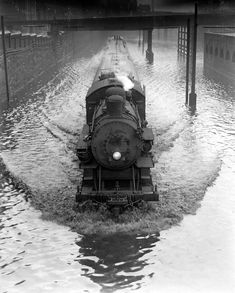a little bit of flooding never slowed, floated, or made it difficult to steer a steam locomotive! Motor A Vapor, Old Steam Train, Photos Originales, Abandoned Train, Bonde, Train Times, Train Art, Old Trains, Train Pictures