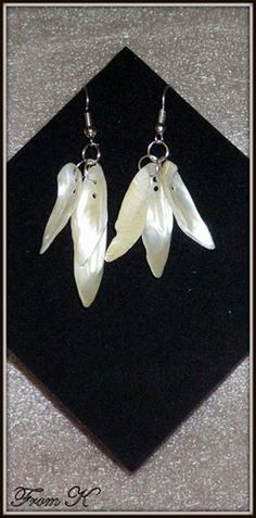 Lightweight #mother #pearl #dangle #earrings. Show off your angelic side with these feather-like earrings. Made with pure white mother of pearl. The sun catches the shades within the mother of pearl making them shimmer. These measure a length of 6 cm with the ear piece, but are as light as a feather. 8.00 Ron Diy Craft Projects, Diy Crafts, Beaded Earrings, Drop Earrings, Mother Pearl, Pure White, Dangles, Feather, Shops