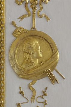 VERSAILLES - detail from the CLOSET of LOUIS XVI, 1788, gilded medallion with the face of Marie-Antoinette    Under the direction of architect Richard Mique, boiseries/ woodwork sculptors: Jean-Siméon and Jean-Hugues Rousseau