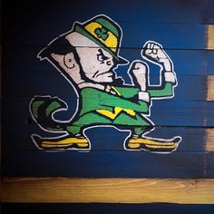 """Just added a new listing that I think turned out pretty cool. A wooden Notre Dame """"Fighting Irish"""" flag. Like all of my Flags it is aged to appear vintage and is available in and Sports Flags, Wooden Flag, Farrah Fawcett, Fighting Irish, Pretty Cool, Notre Dame, American Flag, Snoopy, Silhouette"""