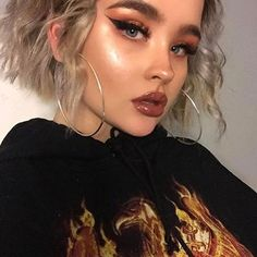 dramatic wing and dewy cheeks.
